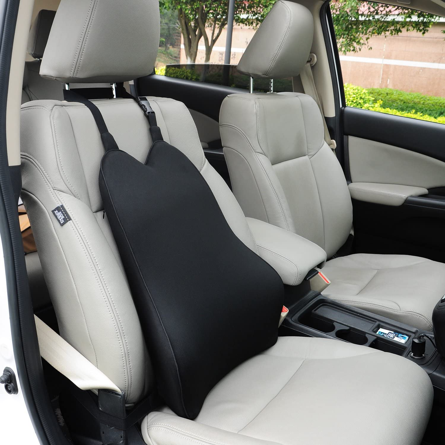 Black seat cushion on the passenger seat fo a car