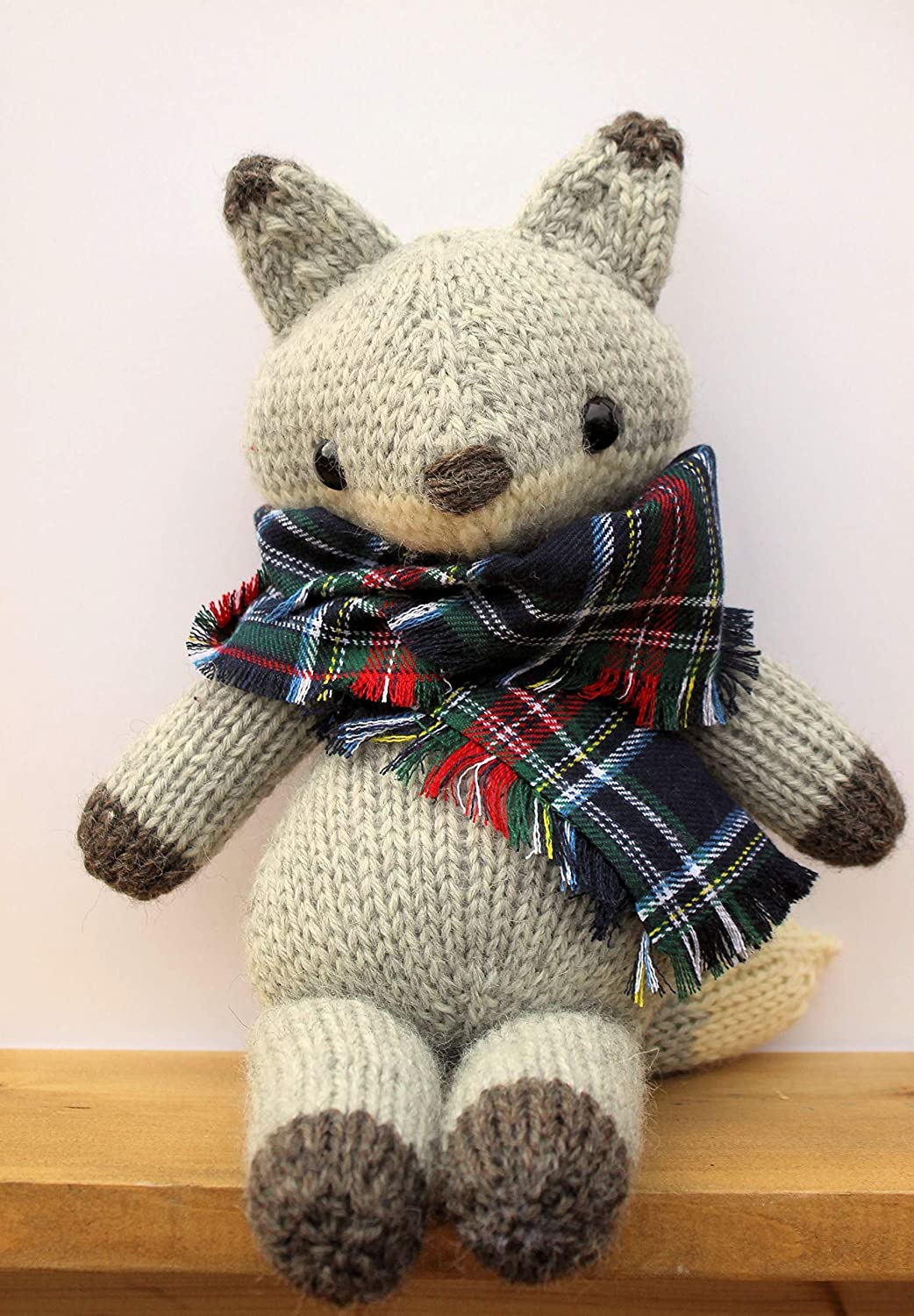 Gray knitted fox with scarf