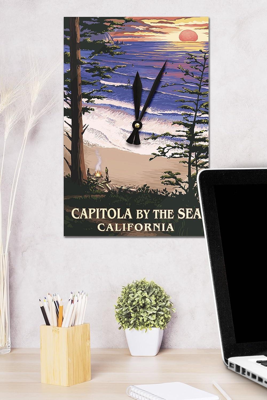 Capitola, California - Capitola por el sol en el mar y reloj de pared surfistas (acrílico): Amazon.es: Hogar