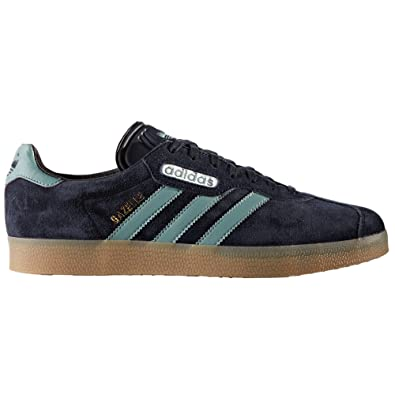 adidas Originals Gazelle Super Beige et Bleu. Chaussures de Sport pour Hommes. Sneakers Tennis Sports (44 2/3 EU, Red/Vintage White/Gold Met.)