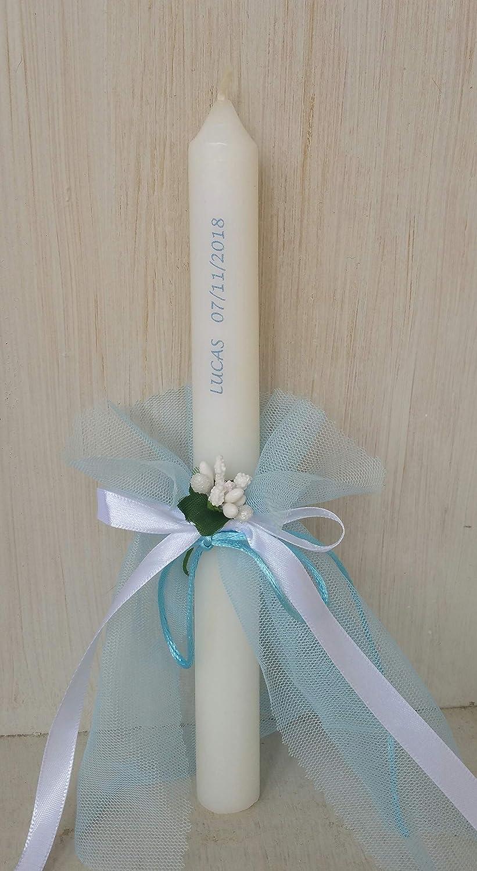 Vela bautizo niño de cera blanca, vela primera comunión,decorada con tul color azul lazos y flor medida altura 25/2.2 cm.