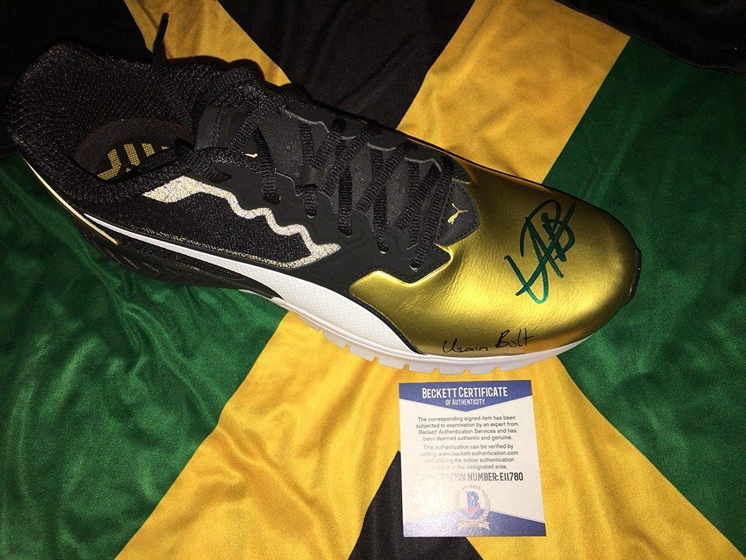 263c61b0eaa1b7 Usain Bolt Signed Official Puma Sneaker Bolt Model Shoe Jamaica Beckett -  Beckett Authentication - Autographed Olympic Products at Amazon s Sports ...