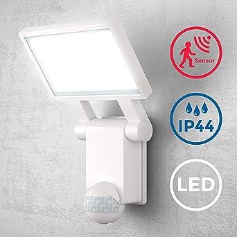 B.K.Licht - Lámpara LED con sensor de movimiento para exteriores, jardín, terraza o patio, con cabeza inclinable, de luz blanca neutral, protección IP44, 20 W y 2000 lúmenes, 4000K, color blanco: Amazon.es: