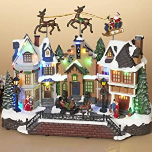 Vintage Light-Up Musical Christmas Town Village Scene with Flying Santa Sleigh Figurines – Lighted Holiday Home Decor – Tabletop Winter Decoration