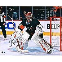 "$79 » Carter Hart Philadelphia Flyers Autographed 16"" x 20"" Black Alternate Jersey In Net Photograph - Autographed NHL Photos"