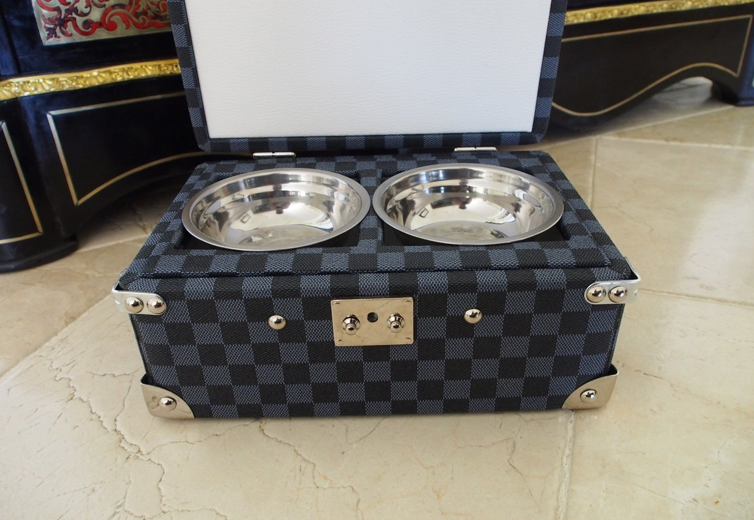 Dog travel bowls in wood covered chest