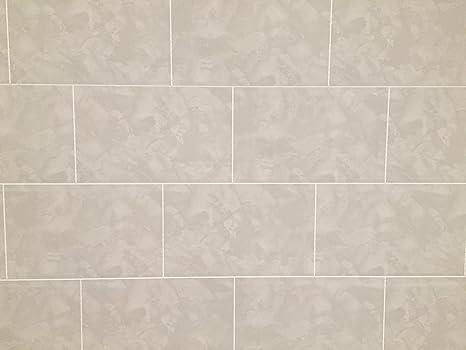 Il rivestimento store cutline grigio effetto marmo piastrella
