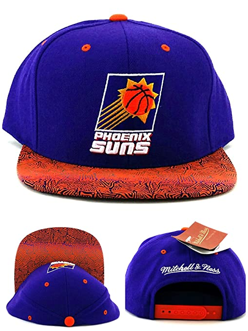 sports shoes 1a47e a2b53 Image Unavailable. Image not available for. Color  Mitchell   Ness Phoenix  Suns New Retro Logo Purple Orange Snapback Era Hat Cap