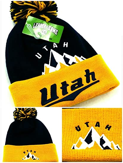 detailed look 1dda6 4b1e0 Amazon.com  Utah Leader Retro Skyline Top Pro Knit Beanie Pom Jazz Colors  Purple Gold Cuffed Era Hat Cap  Sports   Outdoors