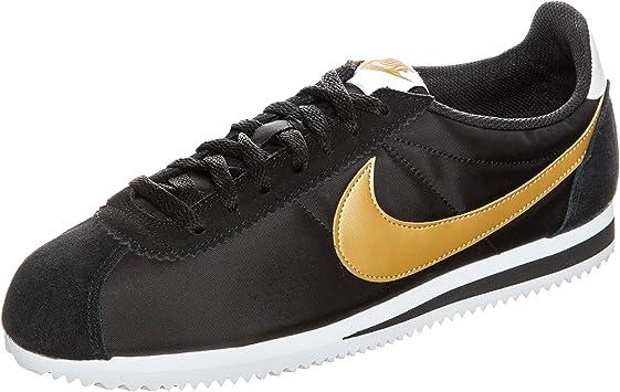zapatillas nike negras y doradas