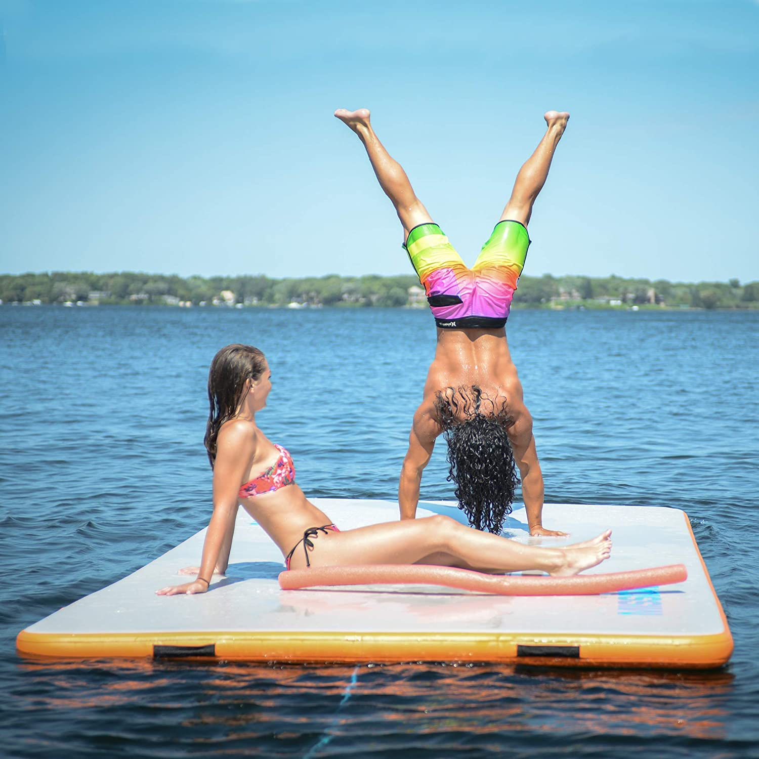 people having fun on an inflatable dock