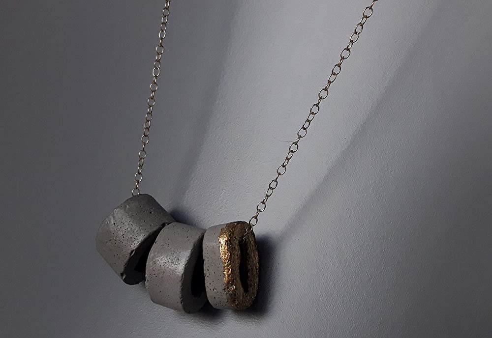 Circle shaped concrete necklace with gold flakes