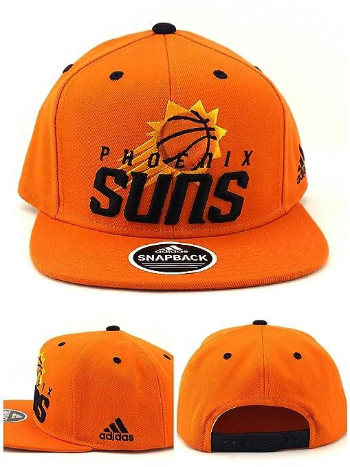 13741ecc9a547 Amazon.com   adidas Phoenix Suns PHX NBA Team Preferred New Logo Orange  Snapback Era Hat Cap   Sports   Outdoors