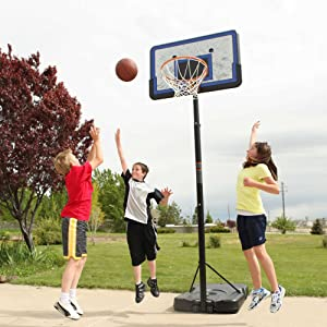 Kids playing basketball with the Lifetime 1221 Pro Court Height Adjustable Portable Basketball System