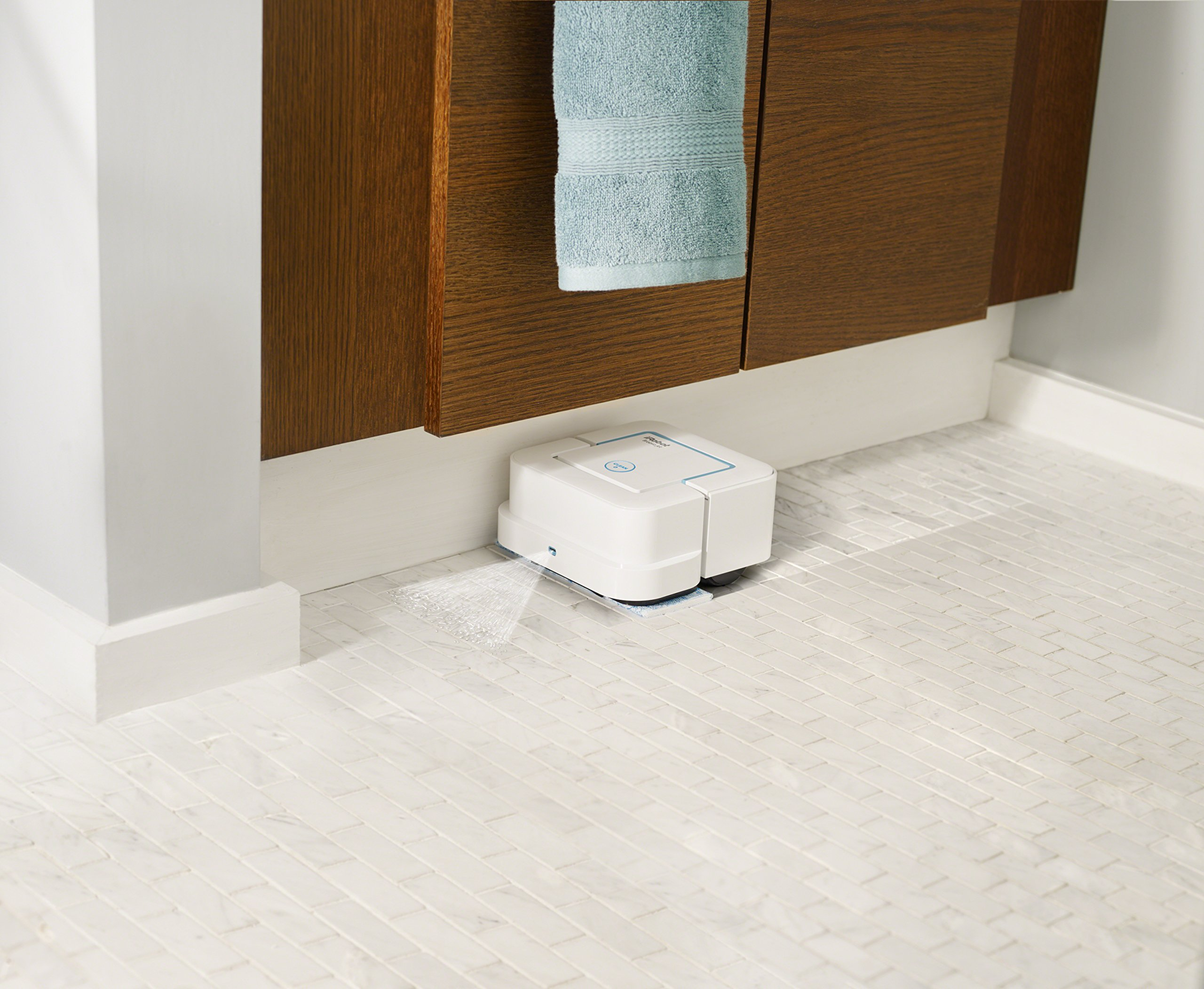 iRobot Braava jet  Robot Mop 5 Mops and sweeps hard floors including hardwood, tile, and stone in kitchens, bathrooms, and other small spaces Gets into hard-to-reach places, including under and around toilets, into corners, and below cabinets Precision Jet Spray and Vibrating Cleaning Head tackle dirt and stains such as dried coffee and soda