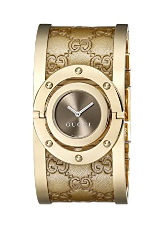 5c3700d149a Gucci Women s YA112434 Twirl Gold Guccissima Leather Bangle Watch   Amazon.ca  Watches