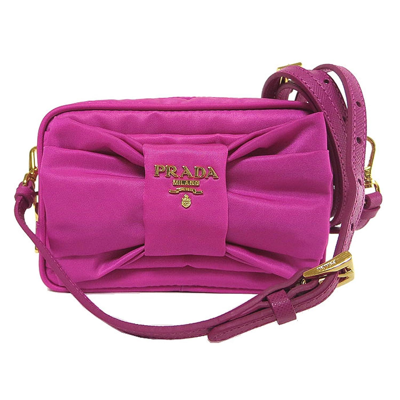 2f431be9fa5b Prada 1N1727 Tessuto Nylon and Leather Bow Crossbody Bag Fuxia Pink   Amazon.ca  Home   Kitchen