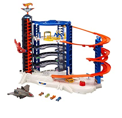 f06c9625f6 Amazon.com  Hot Wheels The Super Ultimate Garage  Toys   Games