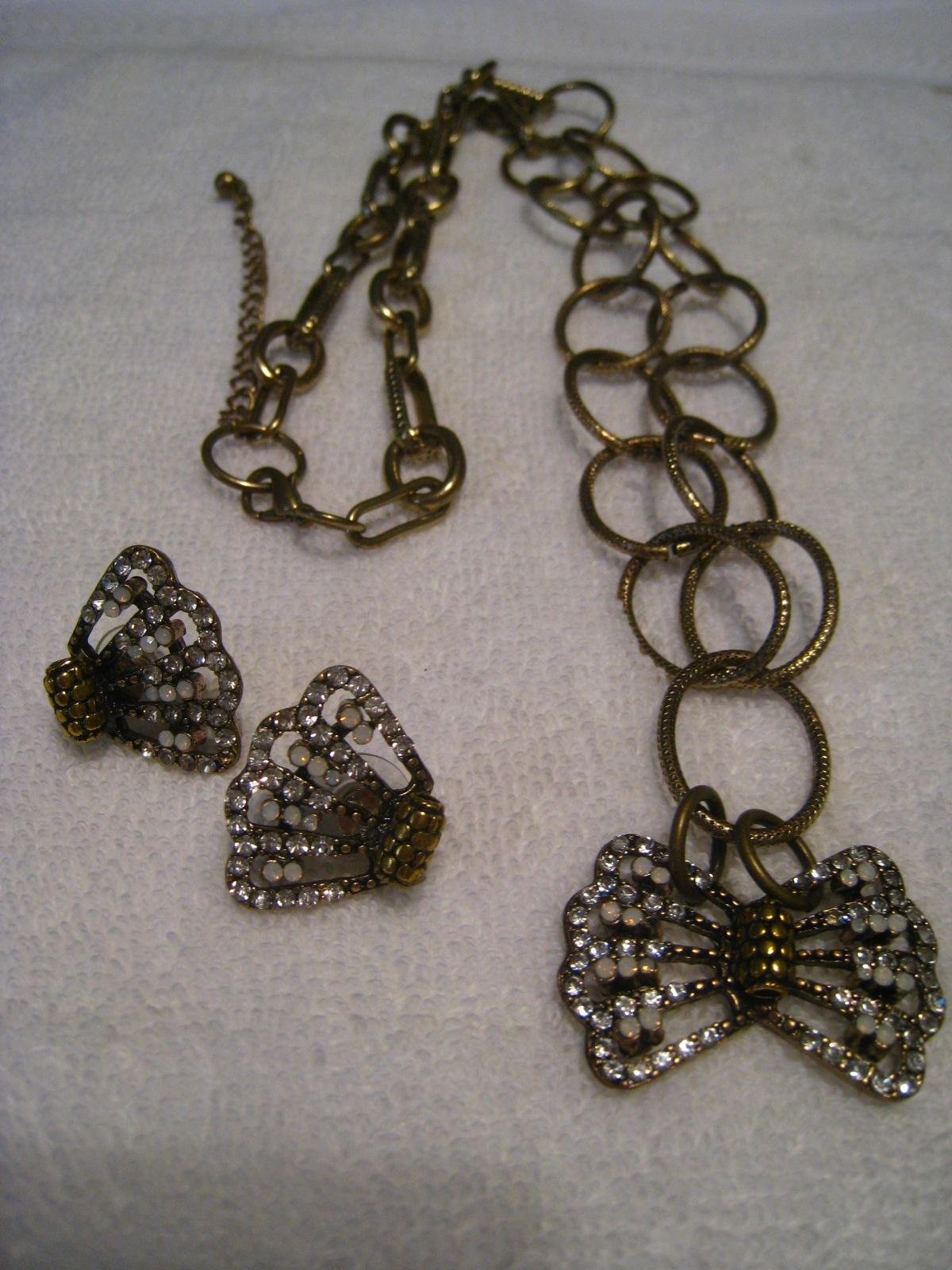 Necklace Pendant style with matching earrings