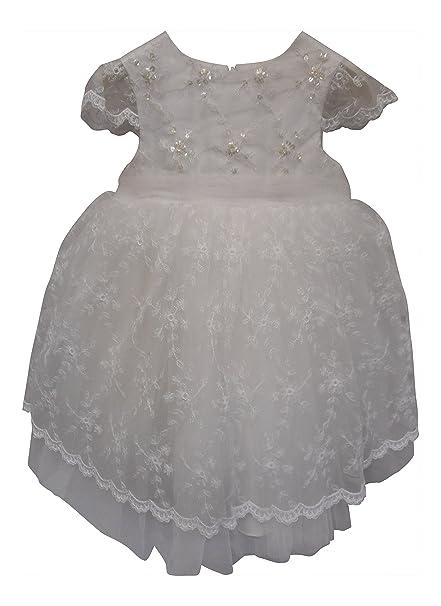 De felicitación para bautizo de la flor de la muchacha de chica de espaldas en ropa