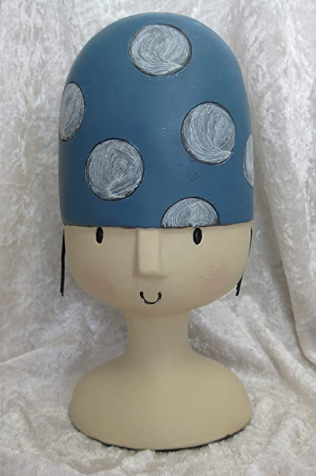 Atril – Cabeza decorativa con gorro puntos flotador