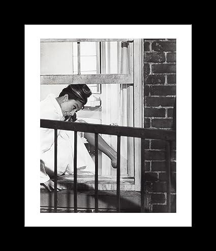 Amazon.com: Film Still Of Audrey Hepburn Climbing Through A Window ...