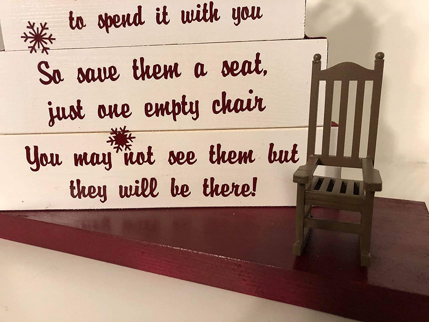 save them a seat with burgandy print and snowflakes burgandy and white ribbon with Rocking chair Christmas White one empty chair Christmas in Heaven
