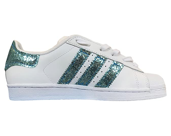 new products 8b1ba 06da1 Superstar bianche con applicazione tessuto glitter azzurro  Amazon.it   Scarpe e borse