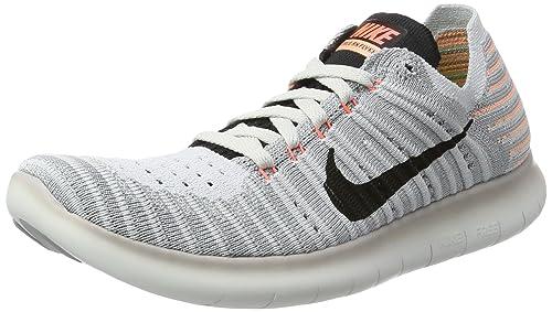 finest selection 52593 1047f Nike Free RN Flyknit, Zapatillas Deportivas para Interior para Mujer   Amazon.es  Zapatos y complementos
