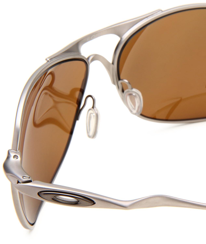 70e3c8c4cc8 Amazon.com  Oakley Titanium Crosshair Men s Polarized Sunglasses - Titanium Tungsten  Iridium  Clothing