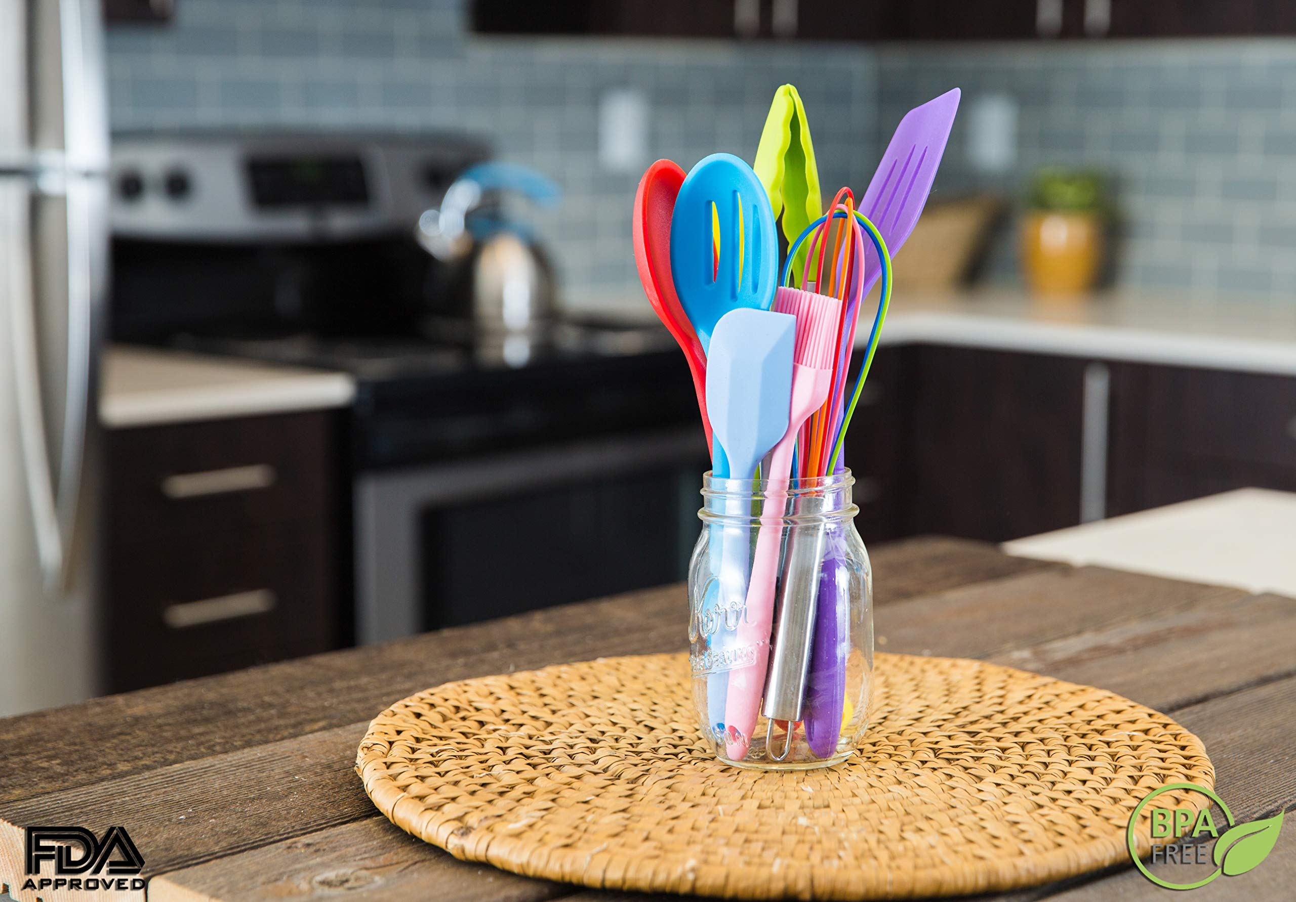 11pc Silicone Kitchen Utensil Set by CuisineFacets Colorful Cooking Utensils with Spatula, Serving Tools, Accessories and FREE Spoon Rest - Heat Resistant Spatulas and Spoons for Non-Stick Cookware 5 ✅11PC incl. FREE SPOON REST: Imagine how many colorful food creations you can now unleash all at once, because your utensil set includes everything! Silicone Wisk, Pastry Brush, 2x Spatulas, Slotted Spoon, Salad Spoon, Food Tong, All-Purpose Spoon, large Ladle, Slotted Turner, and BONUS Spoon Rest. ✅HEAT RESISTANT & EASY TO CLEAN: From the Rainbow Whisk to the Pink Pastry Brush, just pop your silicone kitchen utensils in the dishwasher to clean. Everything is made from FDA Compliant Food Grade Silicone and can withstand temperatures up to 446°F... like steaming hot pasta, pumpkin soup or pancakes. ✅WHAT'S YOUR FAVE? If you're like most people, there are always 1 or 2 kitchen tools you love the most. And if you're like us, it could even be because of color. Either way, our Cheery Utensils Set from CuisineFacets gives you the best of both - your favorite non-stick kitchen utensils, in your favorite colors too.