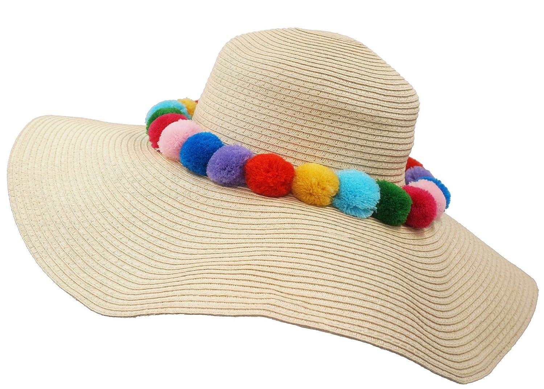 81b15f4100c Roffatide Fluffy Pom Pom Ball Decorated Straw Sun Hat Beach Cap Wide Brim  (4 Colors) Beige at Amazon Women s Clothing store
