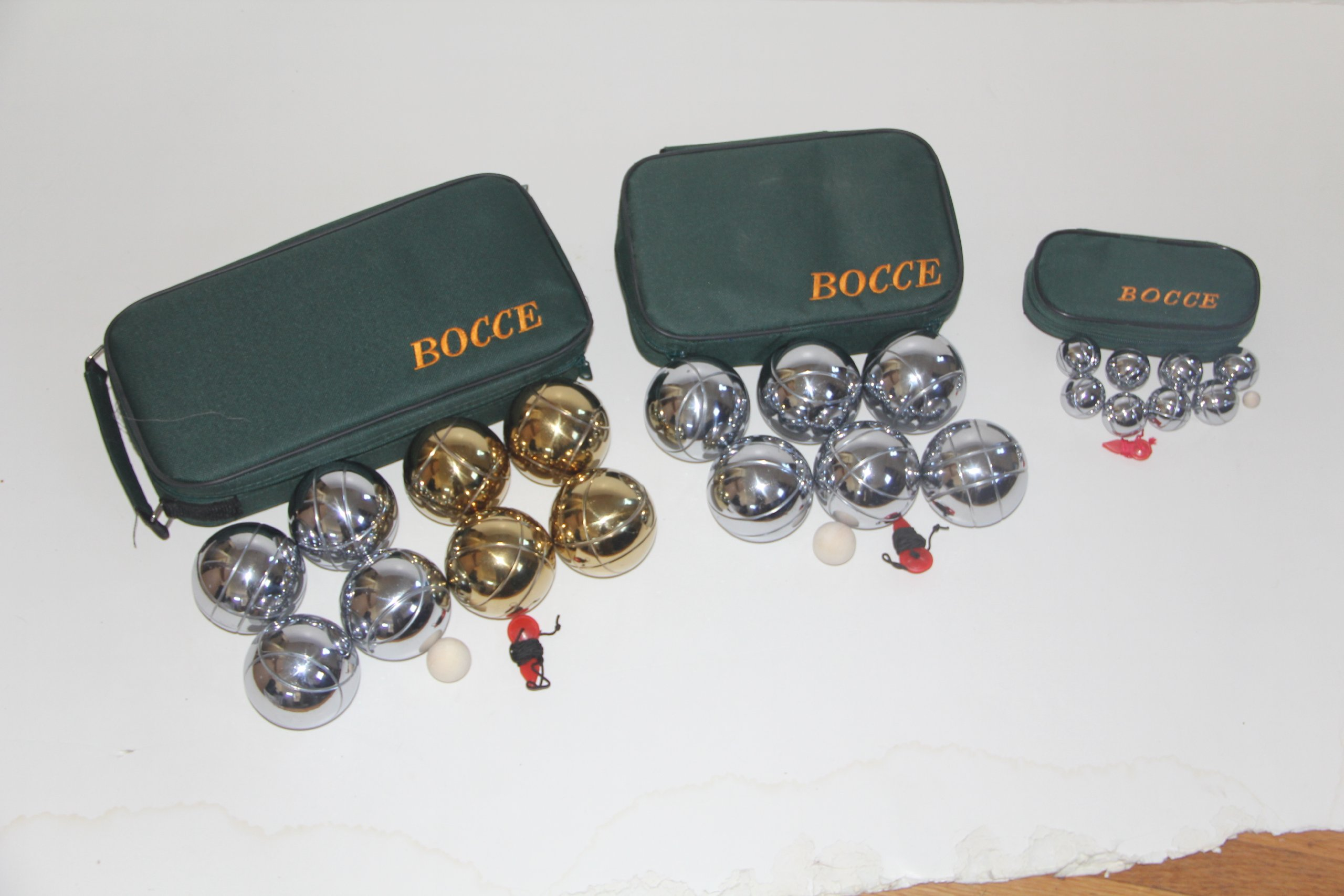 Combo 73mm Metal Bocce, Petanque and Mini Bocce 3 pack with green bags by BuyBocceBalls