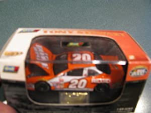 2000 NASCAR Revell Rookie of the Year Edition. . . Tony Stewart #20 Home Depot Pontiac Grand Prix 1/64 Diecast Hood Opens . . . Limited Edition 1 of 12,080 . . . Includes Plastic Case . . . Hood Opens . . . Certificate of Authenticity Enclosed