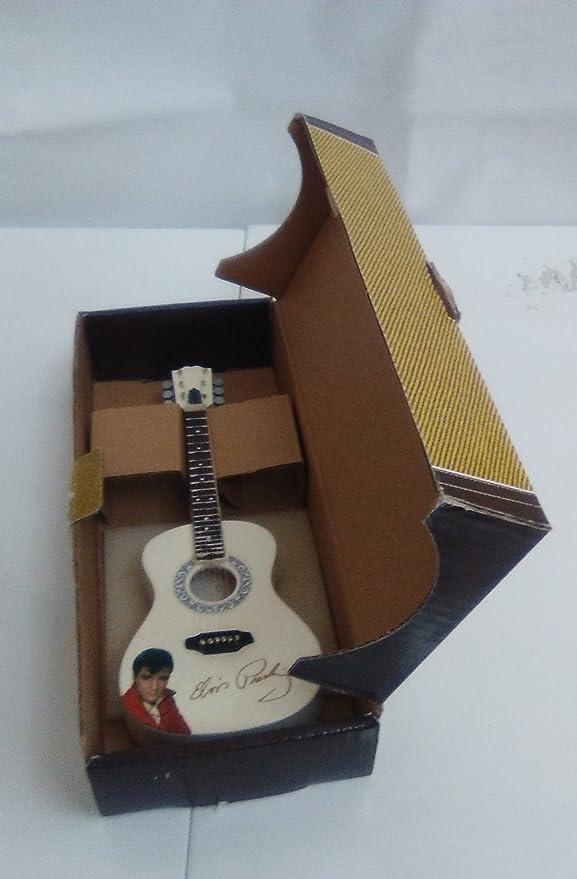 2503-25372-Guitarra eléctrica decorativa en miniatura 17 centimetros «Stratocaster» marrón. en caja de carton: Amazon.es: Hogar