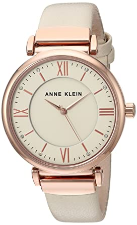 b18103f88 Amazon.com: Anne Klein Women's AK/2666RGIV Swarovski Crystal Accented Rose  Gold-Tone and Ivory Leather Strap Watch: Anne Klein: Watches