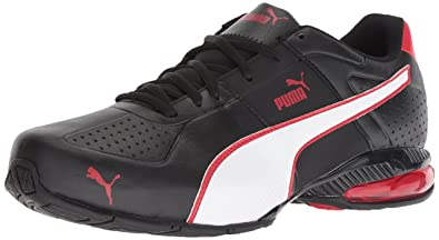 580a5b5f7 PUMA Men's Cell Surin 2 FM Sneaker, Black White-Ribbon red, ...