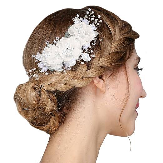 Este broche para el cabello está elaborado totalmente a mano y es ideal para  una boda al estilo clásico. Además 150d44a576a8