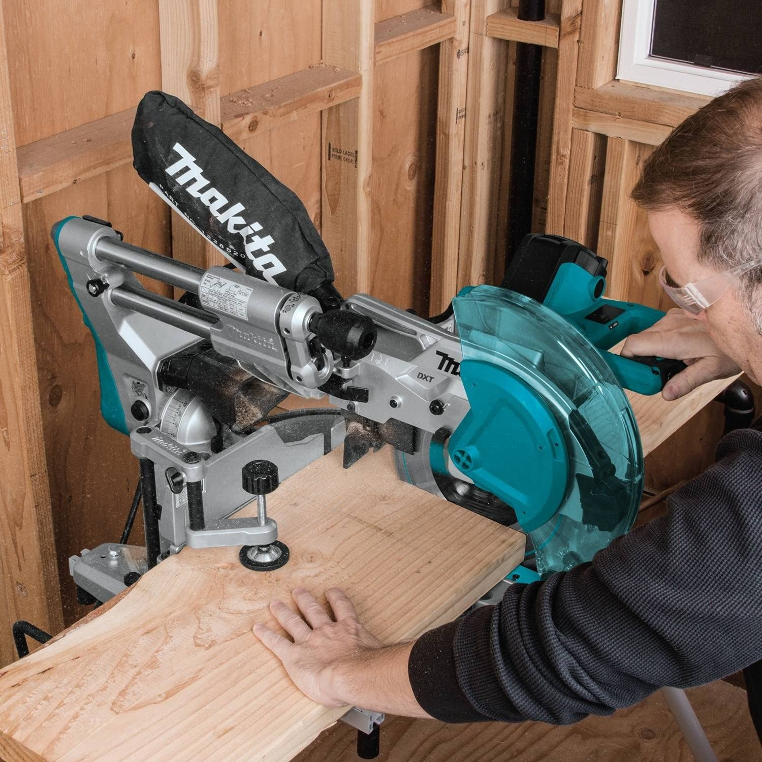 Cutting wood with a sliding compound miter saw
