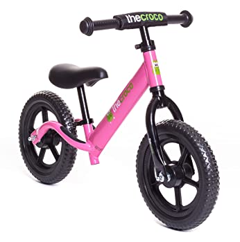 side facing pink croco premium and ultra-light balance bike