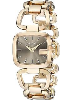 c8a9209549c Amazon.com  Gucci Twirl Gold Dial Ladies Two Tone Bangle Watch ...