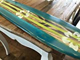 Surfboard wall art. Distressed four foot surfboard