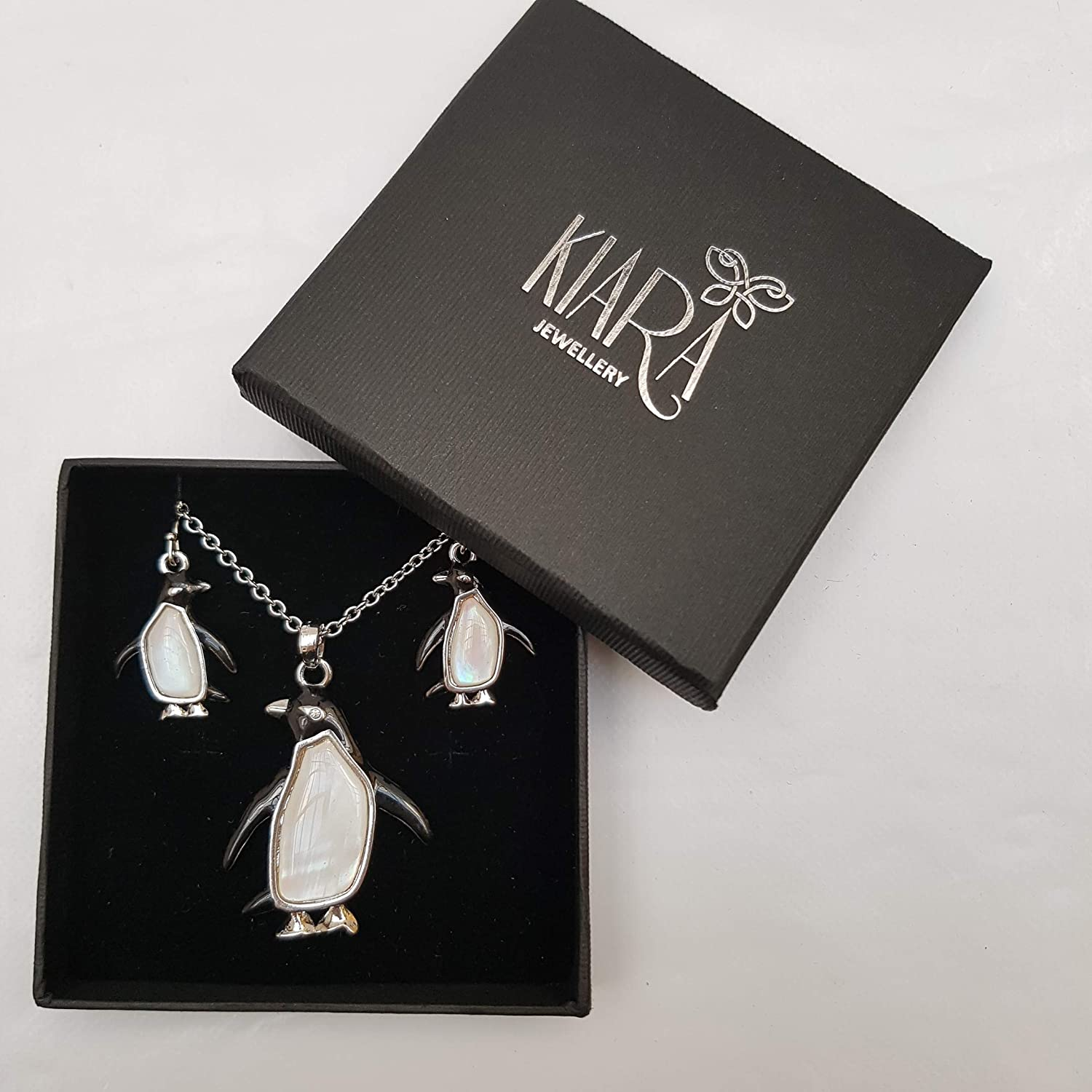 Kiara Jewellery Penguin Boxed Set of Pendant Inlaid With Mother of Pearl on 18 Trace Chain Together With Matching Hypoallergenic Rhodium plated Earrings.
