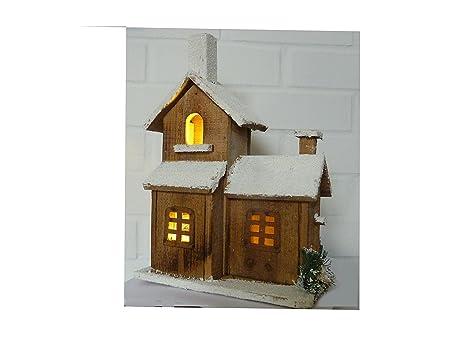 Casetta in legno casa di legno con neve con illuminazione a led