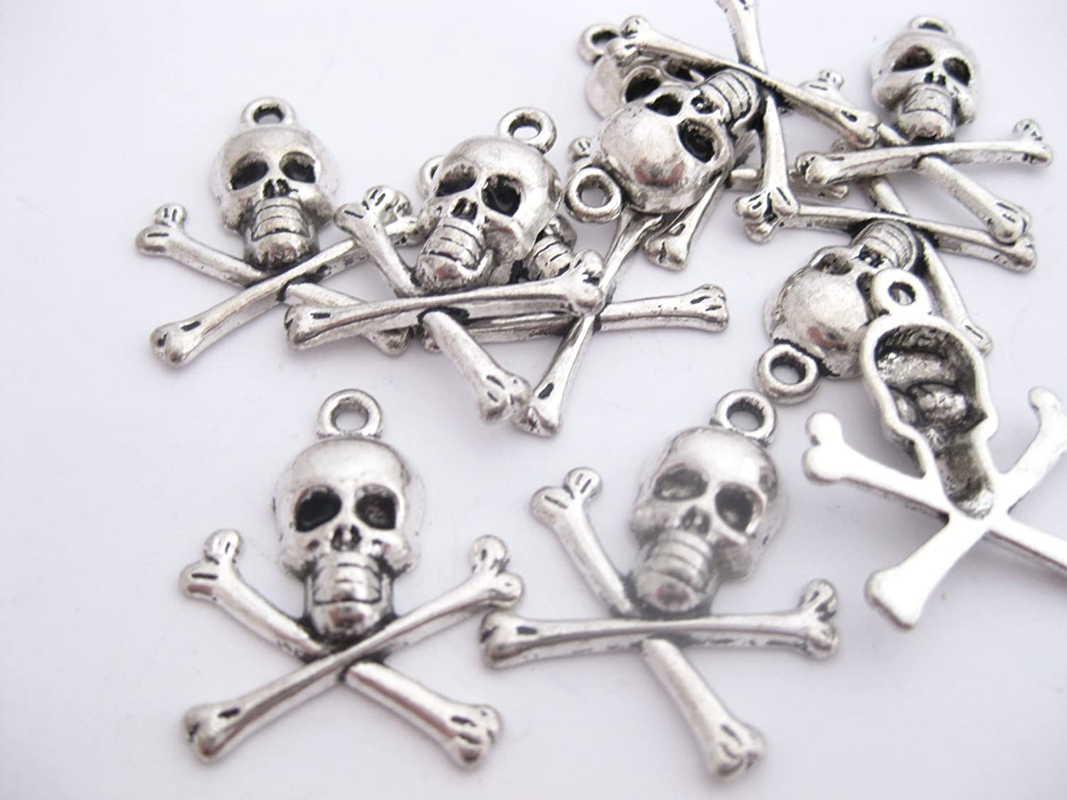 10 Tibetan Style Antique Silver Coloured Skull and Crossbones Charm/ Pendant 24mm x 21mm. CH016 Enchanted Jewels