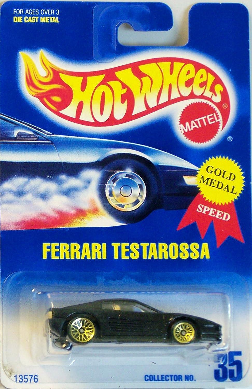 Amazon Com Hot Wheels Ferrari Testarossa Black With Gold Wire Spoke Wheels Blue And White Card 35 Toys Games