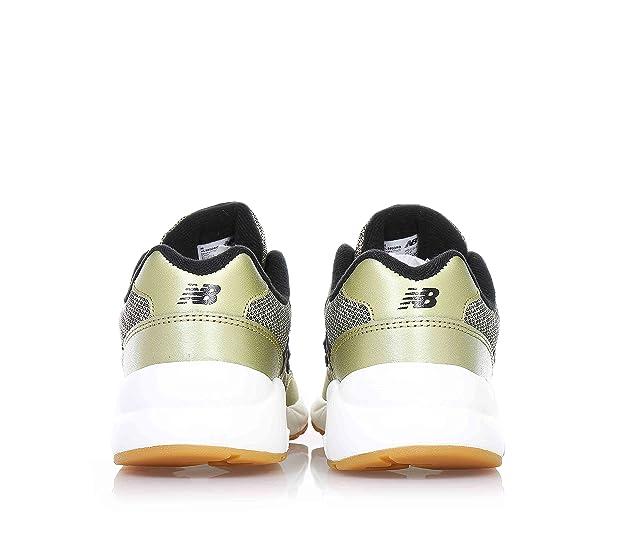 d3f0fcfb929db5 New Balance - Goldene Sportschuhe mit Schnürsenkel