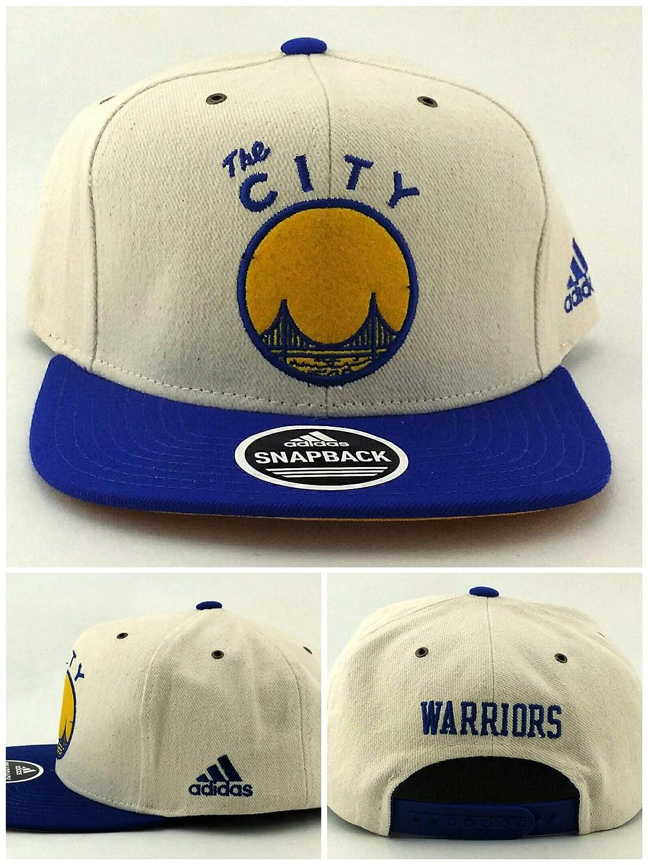 Amazon.com   adidas Golden State Warriors ST New The City Bridge Ivory  White Blue Gold Era Snapback Hat Cap   Sports   Outdoors 74767234b7cc