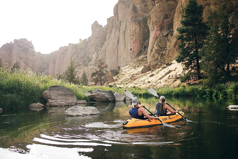 two people paddling in kayak on a lake
