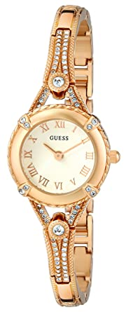 aa83b63f78e9 GUESS Petite Vintage Inspired Gold-Tone Crystal Bracelet Watch with Self- Adjustable Links.